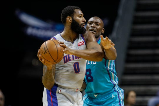 Detroit Pistons center Andre Drummond looks to pass the ball as Charlotte Hornets center Bismack Biyombo defends during the first half in Charlotte, N.C., Friday, Nov. 15, 2019.