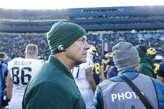 Michigan State head coach Mark Dantonio walks off the field after the Spartans lost 44-10 to the Wolverines at Michigan Stadium in Ann Arbor, Saturday, Nov. 16, 2019.