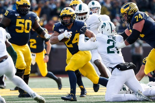 Michigan running back Zach Charbonnet runs against Michigan State during the first half at Michigan Stadium on Saturday, Nov. 16, 2019.