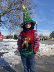 7-year-old Liam Thornfelt of Flatrock walked in the 76th Annual Wyandotte Christmas Parade with the Wyandotte Cub Scouts.