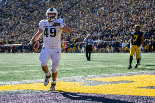 Michigan State fullback Max Rosenthal runs in a touchdown during the first quarter at Michigan Stadium on Saturday, Nov. 16, 2019.