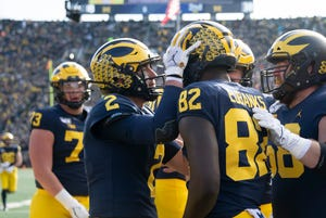 Michigan quarterback Shea Patterson (2) celebrates after throwing a touchdown pass to tight end Nick Eubanks (82) in the second quarter.