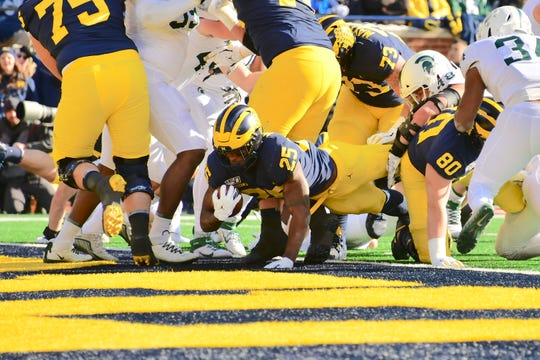 Michigan's Hassan Haskins scores on a 1-yard run in the second quarter on Saturday.
