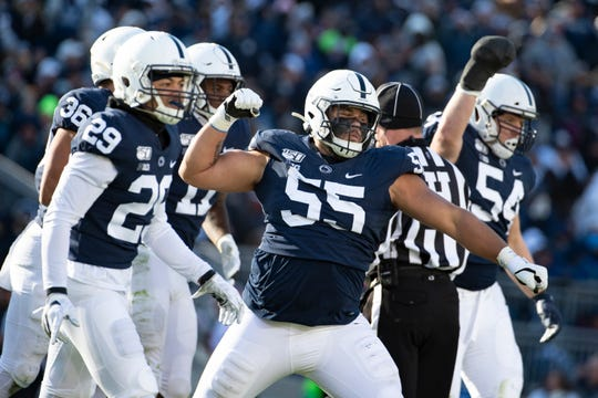 Penn State defensive tackle Antonio Shelton (55) celebrates after stopping Indiana tight end Peyton Hendershot (86) on a fake punt in the third quarter on Saturday.