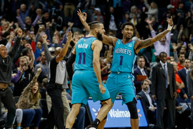 Charlotte Hornets guard Malik Monk, right, celebrates with Cody Martin after Monk hit the game-winning 3-pointer as time expired.
