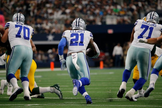 The Lions' defensive line will look to prevent Cowboys' Zack Martin (70) and La'el Collins (71) from clearing running lanes for Ezekiel Elliott (21) on Sunday.