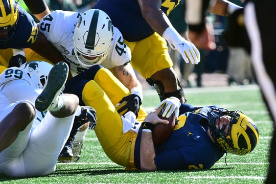 Michigan quarterback Shea Patterson is sacked by Michigan State on the first drive of the game on Saturday.