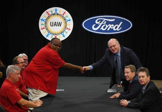 Then-UAW Vice President Rory Gamble and Jim Hackett, President and CEO of Ford Motor Co., shake hands at the start of contract negotiations.