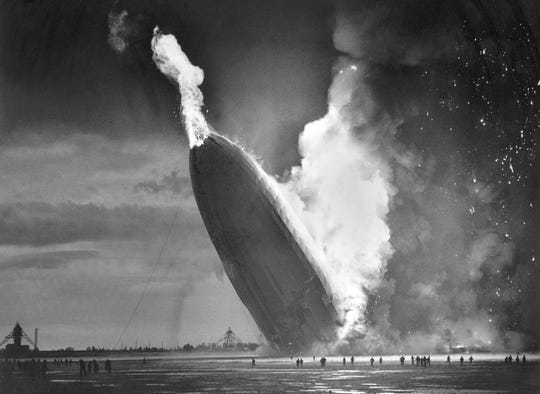 The German dirigible Hindenburg crashes to earth in flames after exploding at the U.S. Naval Station in Lakehurst, N.J. on May 6, 1937.