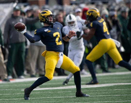 Michigan quarterback Shea Patterson throws a pass in the second half. Patterson threw for 384 yards and four touchdowns against the Spartans.