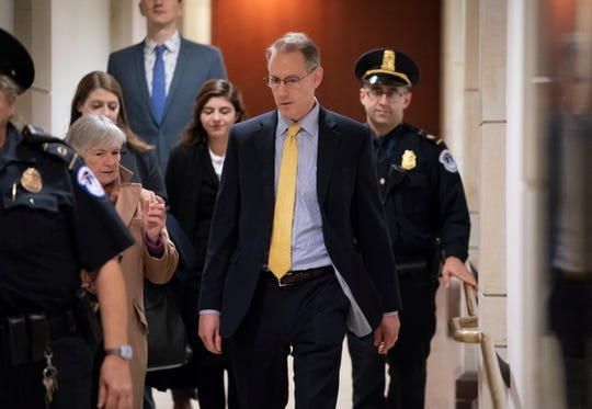 Mark Sandy, a career employee in the White House Office of Management and Budget, arrives at the Capitol to testify in the House Democrats' impeachment inquiry in Washington, Saturday, Nov. 16, 2019.