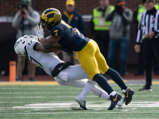 Michigan linebacker Khaleke Hudson clobbers Michigan State wide receiver Tre Mosley on an incomplete pass play in the second half.