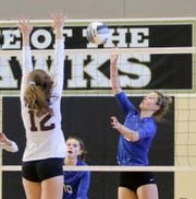 Carolyn Bovaird of Horseheads hits the ball over the net in front of Ossining's Fiona Farmakopoulos during a Class AA volleyball regional final Nov. 16, 2019 at Corning-Painted Post High School.