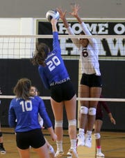 Ossining's Mychael Vernon goes for a block against Cameron Knapp of Horseheads during a Class AA volleyball regional final Nov. 16, 2019 at Corning-Painted Post High School.