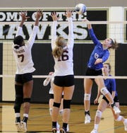 Taylor Malone of Horseheads hits the ball over the net in front of Ossining's Ede Walker (7) and Ashley Pavarini (16) during a Class AA volleyball regional final Nov. 16, 2019 at Corning-Painted Post High School.