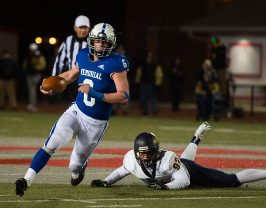 Brock Combs evades the grasp of Mooresville's Tommy O'Connor in Memorial's 17-14 victory in a Class 4A regional Friday at Enlow Field.