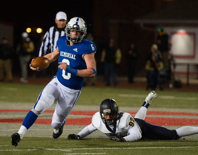 Mooresville's Tommy O'Connor(92) fails to stop Memorial's Brock Combs (6) at the Mooresville vs Memorial game at Enlow Field in Evansville, Ind., Friday, Nov. 15, 2019.