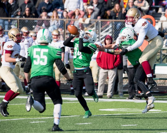 Triton Central's Ben Riggins (34) intercepts a pass in the 4th quarter of the Triton Central Tigers vs Mater Dei Wildcats Class 2A regional game at Tiger Stadium in Fairland, Ind., Saturday afternoon, Nov. 16, 2019. The Tigers won, 13-7.