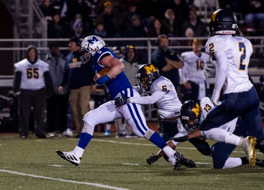 Mooresville's Kyler Evans (6) tackles Memorial's Brock Combs (6) at the Mooresville vs Memorial game at Enlow Field in Evansville, Ind., Friday, Nov. 15, 2019. Memorial won 17-14 over Mooresville in the Class 4A regional. They will advance to semistate for the third straight season.