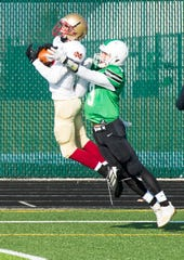 Mater Dei's Preston Turner (21) catches a pass in the end zone to score the only touchdown for the Wildcats during the Class 2A regional game against the Triton Central Tigers at Tiger Stadium in Fairland, Ind., Saturday afternoon, Nov. 16, 2019.
