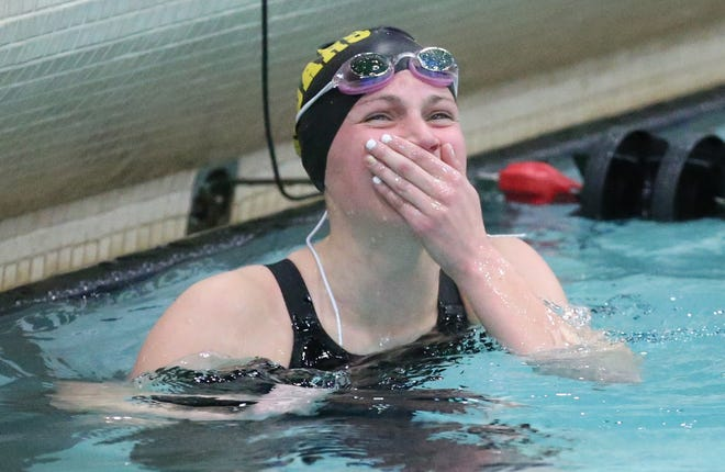 Ashwaubenon's Hallory Domnick reacts after winning the 500-yard freestyle at the WIAA Division 2 state meet Nov. 15, 2019, in Madison.