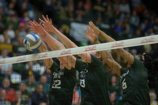 Colorado State volleyball players, from left, Katie Oleksak, Kirstie Hillyer and Breana Runnels block a shot during a win over Boise State at Moby Arena on Saturday, Nov. 16, 2019.
