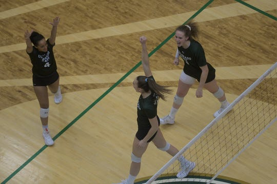CSU volleyball players Brooke Hudson (4), Paulina Hougaard-Jensen (middle) and Olivia Nicholson celebrate after winning a point against Boise State on Nov. 16, 2019. Hougaard-Jensen recorded 10 kills as the Rams defeated San Jose State in 5 sets Thursday night.