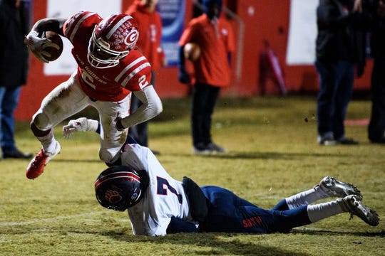 Greenville's Khalique Holland (2) is taken down by BHP's Semaj Groves (7) during their game Friday, Nov. 15, 2019.