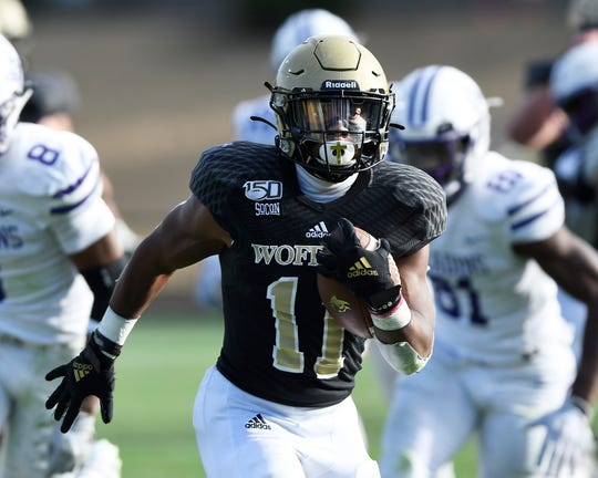 Wofford's Blake Morgan (11) scores on a 29 yard run to open the third quarter against Furman.