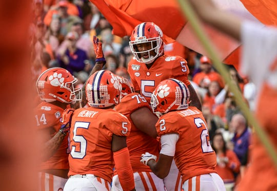 Clemson wide receiver Tee Higgins (5) is hoisted in high after a touchdown catch against Wake Forest during the second quarter at Memorial Stadium in Clemson, South Carolina Saturday, November 16, 2019.
