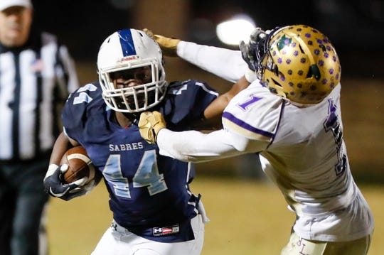 Southside Christian's Malory Pinkney (44) stiff arms Batesburg-Leesville's Keshoun Williams (1) to clear a path down field during the Southside Christian Batesburg-Leesville playoff game Friday, November 15, 2019.