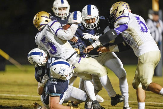 Batesburg-Leesville's Amah-Dre Leaphart(5) is swarmed by the Sabre defense during the Southside Christian Batesburg-Leesville playoff game Friday.