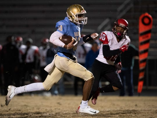 D.W. Daniel's Hackario Hamilton (10) carries the ball to the end zone for a touchdown during the game against Westwood High School at D.W. Daniel High School Friday, Nov. 15, 2019.