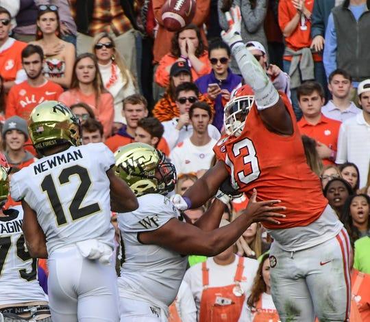 Clemson defensive lineman Tyler Davis(13) blocks a pass by Wake Forest quarterback Jamie Newman(12) during the first quarter at Memorial Stadium in Clemson, South Carolina Saturday, November 16, 2019.