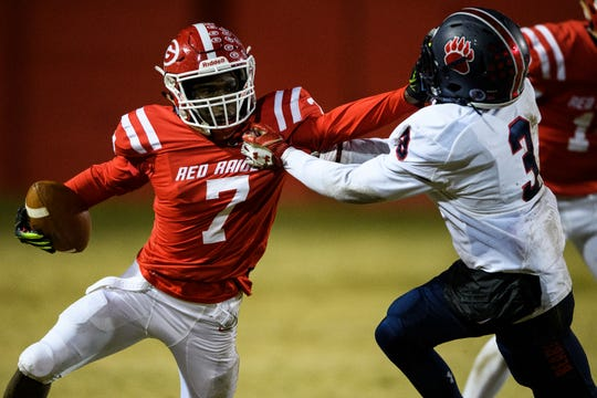 Greenville's Aziz Huff (7) attempts to push past BHP's English Johnson (3) during their game Friday, Nov. 15, 2019.