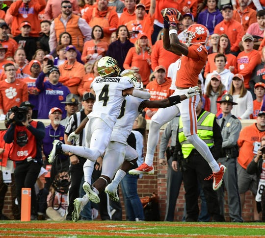 Clemson wide receiver Tee Higgins (5) catches a pass near Wake Forest defensive back Amari Henderson(4) for a touchdown during the second quarter at Memorial Stadium in Clemson, South Carolina Saturday, November 16, 2019.