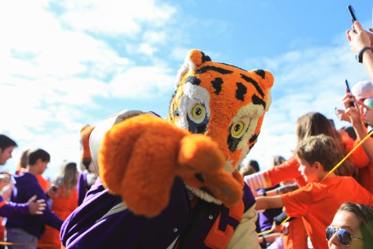 Fans greet players and cheer on the Tigers during the Clemson Tiger Walk at Memorial Stadium before the final home game of the season against Wake Forest, Saturday, Nov. 16, 2019.