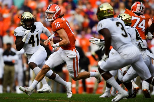Clemson quarterback Trevor Lawrence (16) attempts to advance past Wake Forrest defense during their game Saturday, Nov. 16, 2019.