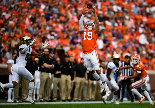 Clemson defensive back Tanner Muse (19) catches the interception intended for Wake Forest receiver Waydale Jones(80) during their game Saturday, Nov. 16, 2019.