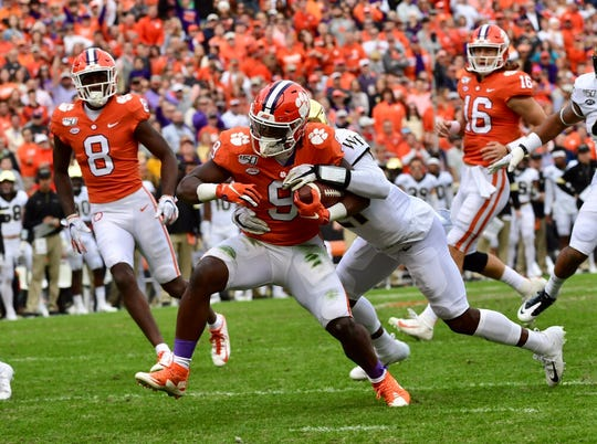 Clemson running back Travis Etienne (9) scores a rushing touchdown in the first quarter against Wake Forest on Saturday, Nov. 16, 2019.