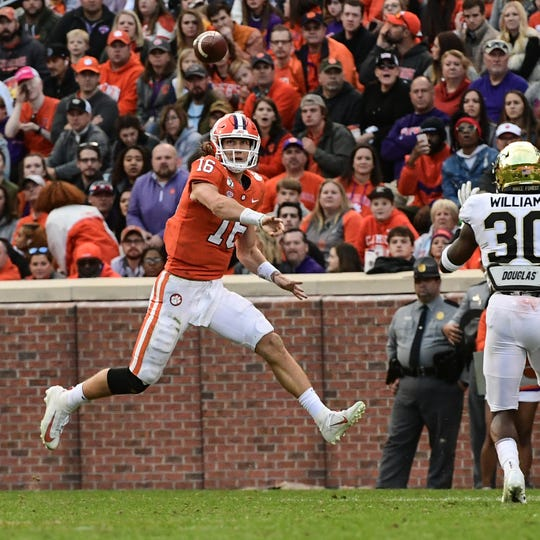 Clemson quarterback Trevor Lawrence (16) passes to wide receiver Diondre Overton (14) during the second quarter at Memorial Stadium in Clemson, South Carolina Saturday, November 16, 2019.