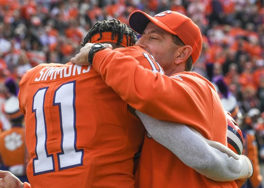Clemson Head Coach Dabo Swinney hugs senior Isaiah Simmons (11) in a senior day ceremony before the game at Memorial Stadium in Clemson, South Carolina Saturday, November 16, 2019.