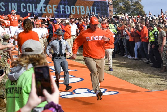 Clemson Head Coach Dabo Swinney runs down the hill before the game at Memorial Stadium in Clemson, South Carolina Saturday, November 16, 2019.