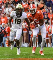 Clemson wide receiver Tee Higgins (5) catches a pass near Wake Forest defensive back Trey Rucker(18) for a touchdown during the second quarter at Memorial Stadium in Clemson, South Carolina Saturday, November 16, 2019.