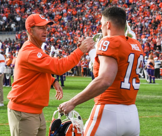 Clemson Head Coach Dabo Swinney greets defensive back Tanner Muse (19) in a senior day ceremony before the game at Memorial Stadium in Clemson, South Carolina Saturday, November 16, 2019.