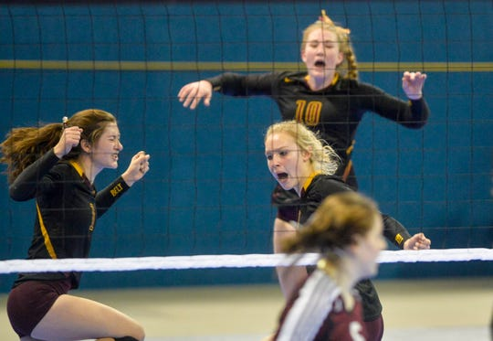 Belt celebrates a point in the the third place match at the state volleyball tournament on Saturday in Bozeman.
