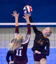 Belt's Shelby Paulson attacks at the net as Manhattan Christian's Hailey VanDyken defends during the third place match at the state volleyball tournament on Saturday in Bozeman.