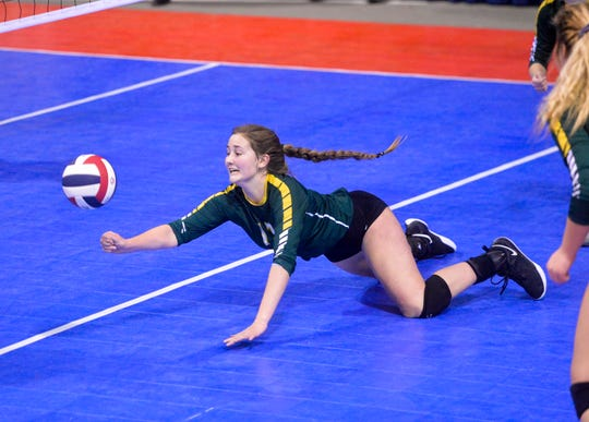 CMR's Natalie Bosley saves the point during the third place match of the state volleyball tournament in Bozeman on Saturday.