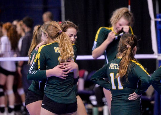 The CMR volleyball team reacts after their loss to Helena High in the third place match of the state volleyball tournament in Bozeman on Saturday.
