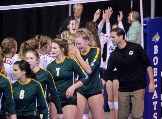 CMR and Helena High shake hands at the end of the third place match at the state volleyball tournament in Bozeman Saturday.  CMR earned third place in the three game match against Helena High.